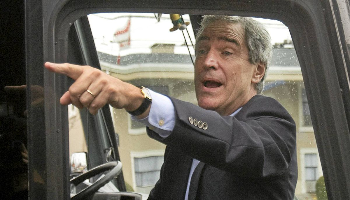Liberal Leader Michael Ignatieff boards his campaign bus in Vancouver on March 20, 2011.