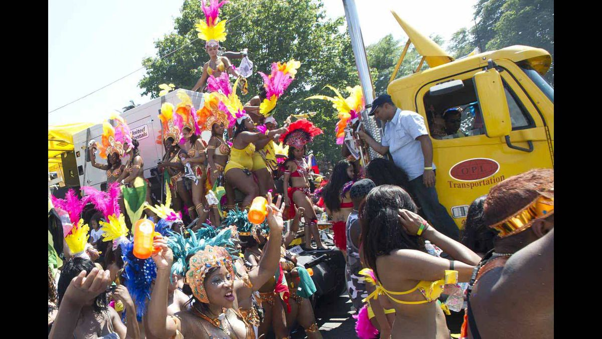 Crowds gather along the Caribbean Carnival parade route in Toronto on July 30, 2011.