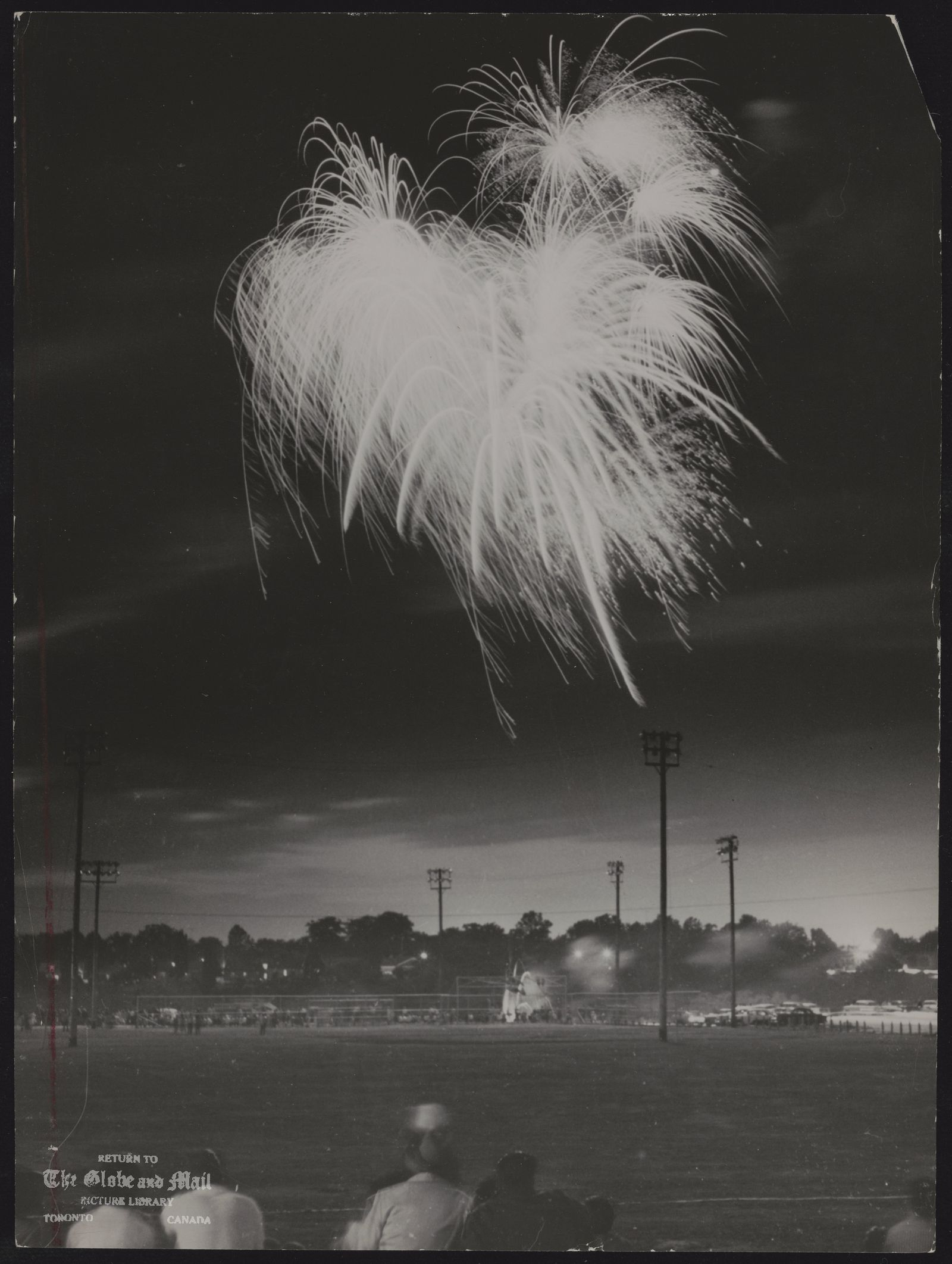 The notes transcribed from the back of this photograph are as follows: [July 1, 1960], fireworks over Cedarvale Park mark DOMINION DAY