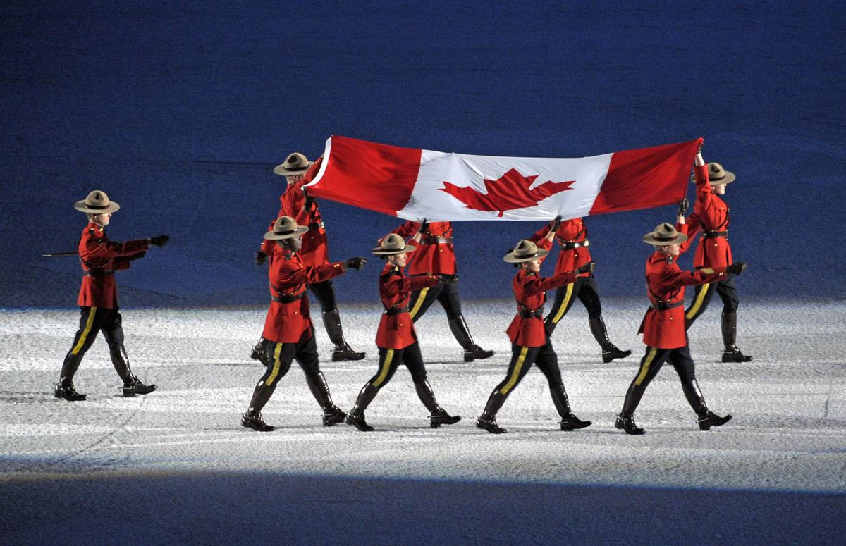 Mounties carry in the Canadian flag into B.C. Place during the opening ceremonies of the Vancouver Winter Olympics on Feb. 12, 2010.