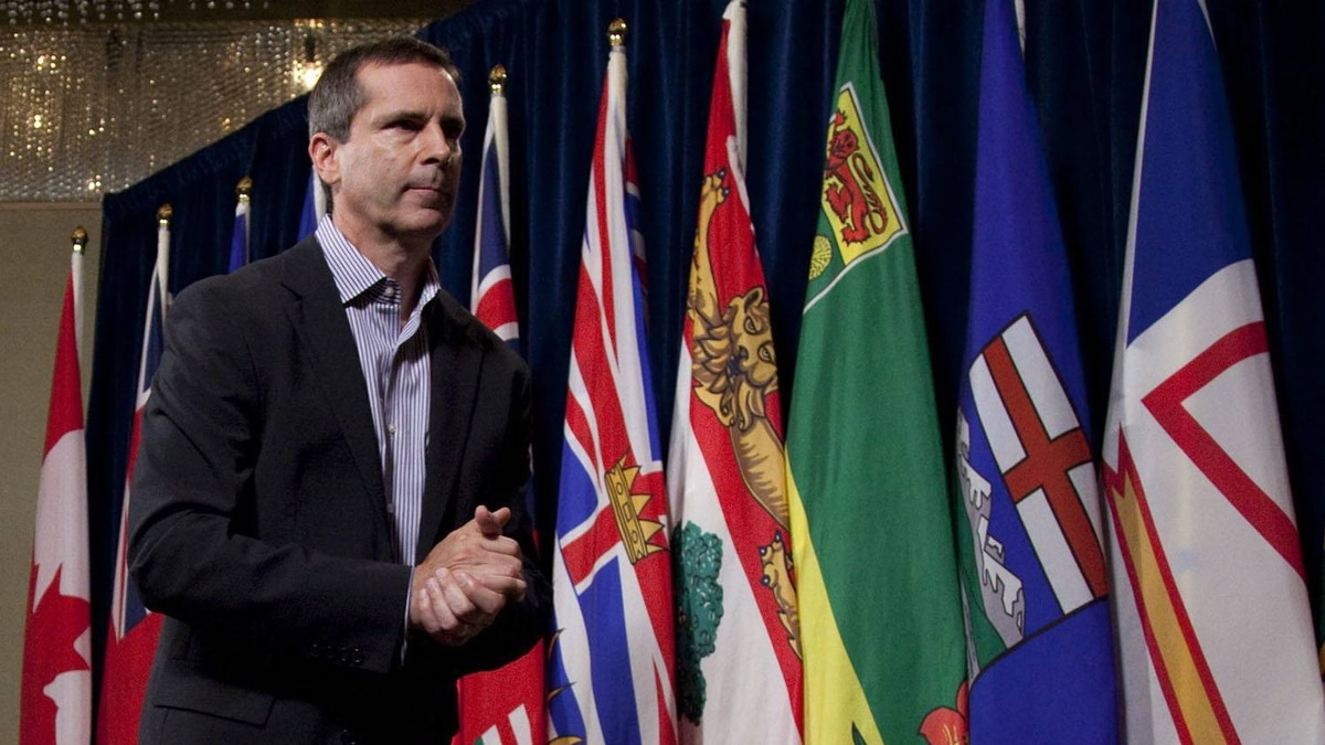 Ontario Premier Dalton McGuinty leaves after speaking to the media following a meeting of the Council of the Federation in Vancouver, Thursday, July 21, 2011.