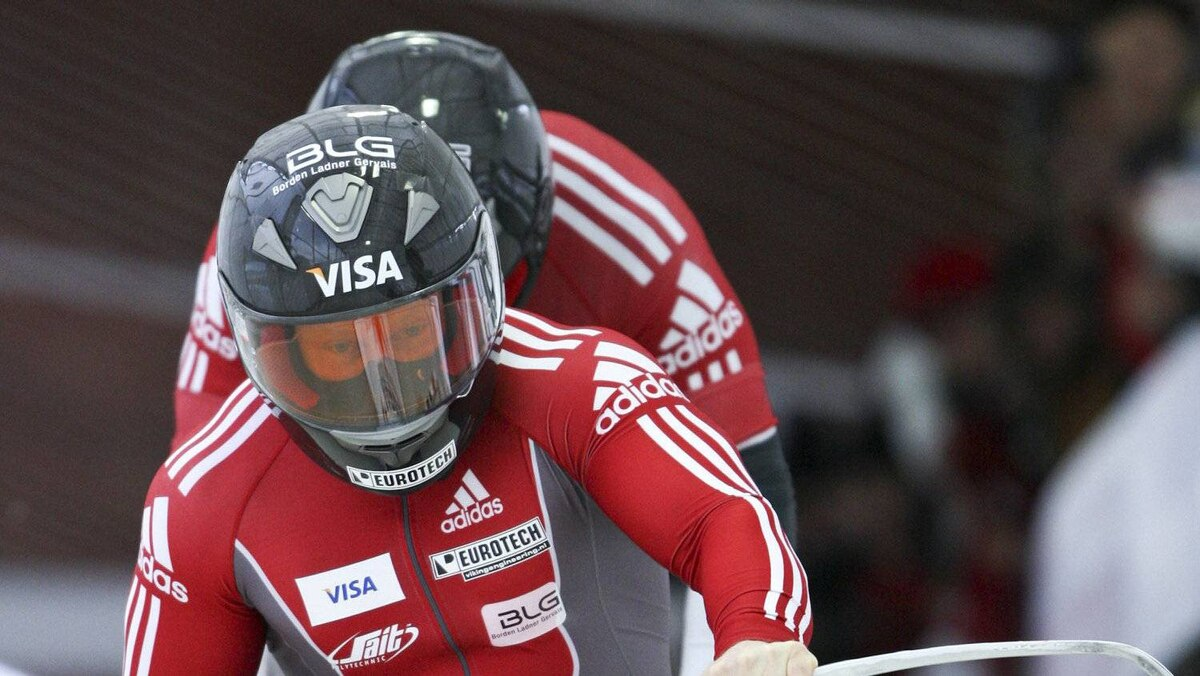 Lyndon Rush (front) and Jesse Lumsden of Canada compete in the first run of the men's bobsleigh at the FIBT World Bobsleigh Championships in Lake Placid, New York February 18, 2012.