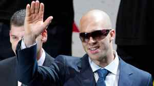 Vancouver Canucks' alternate captain Manny Malhotra waves to the crowd during the presentation of the President's Trophy prior to an NHL hockey game against the Minnesota Wild in Vancouver, B.C., on Thursday April 7, 2011. The trophy is awarded to the team that finishes in first place overall in the league. Malhotra underwent eye surgery after he was hit by a puck in March. THE CANADIAN PRESS/Darryl Dyck