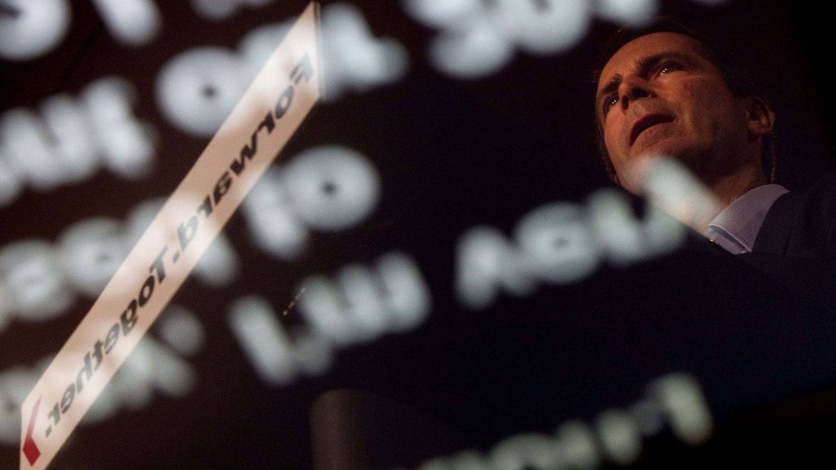 Ontario Premier Dalton McGuinty is reflected in a teleprompter as he releases the Liberal party platform in Toronto on Sept. 5, 2011.
