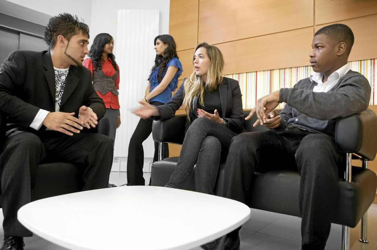 Mentoring programs are flourishing at top-rung companies across the country. Chris Schmidt / iStockphoto