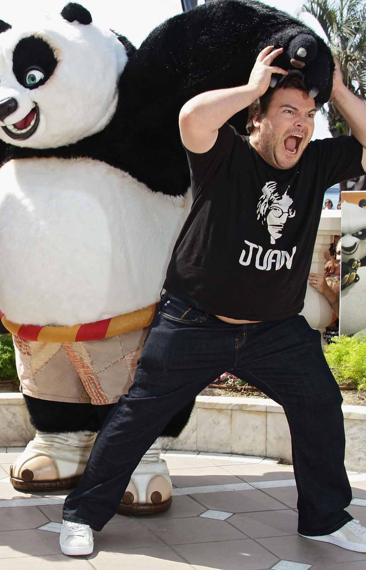 "Jack Black is his usual asinine self during a photo call for ""Kung Fu Panda 2"" at the Cannes Film Festival on Thursday."