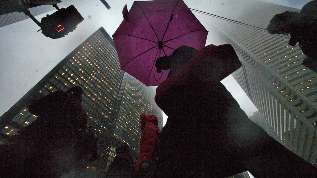People walk through a foggy scene on Bay Street in the financial district in Toronto on Feb. 18, 2009.