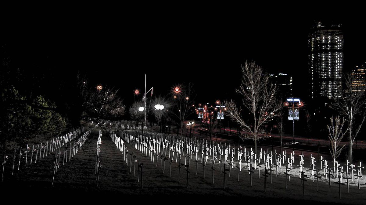 Larry Kwan photo: Calgary Remembers 2010 - These crosses are erected on Memorial Drive each year to commemorate fallen soldiers from the city. The city lights of Chinatown and the Bow Tower are in the background.