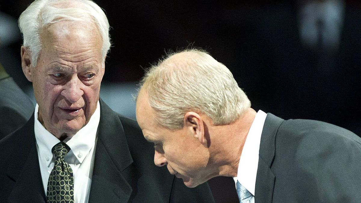 Hockey Hall of Fame inductee Mark Howe, right, talks to his father Gordie Howe, left, as they take part in a ceremony before the Toronto Maple Leafs take on the Ottawa Senators in NHL hockey action in Toronto on Saturday, Nov. 12, 2011. THE CANADIAN PRESS/Nathan Denette