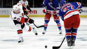 New York Rangers Ryan McDonagh (R) blocks a shot by Ottawa Senators Erik Karlsson during the second period of Game 2 of their NHL Eastern Conference quarter-final playoff game at Madison Square Garden in New York April 14, 2012.