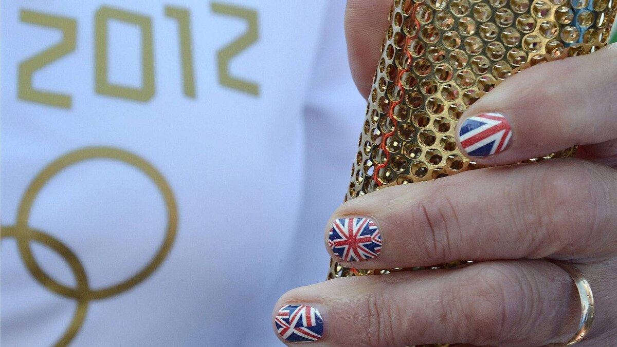 A torchbearer holds onto her torch in England May 19, 2012.