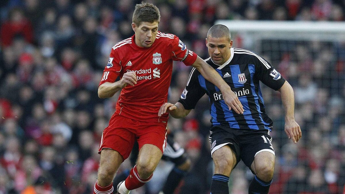 Liverpool's Steven Gerrard (L) challenges Stoke City's Jonathan Walters (R) during their English Premier League soccer match at Anfield in Liverpool, northern England, January 14, 2012.