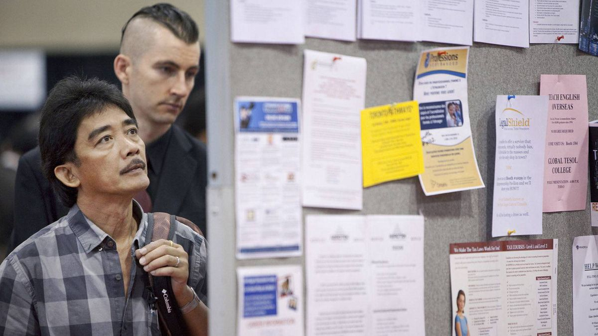 Alex Dagorio looks at the pin-up boards during the 19th edition of the National Job Fair and Training Expo at the Metro Toronto Convention Centre on Tuesday, September 27, 2011.