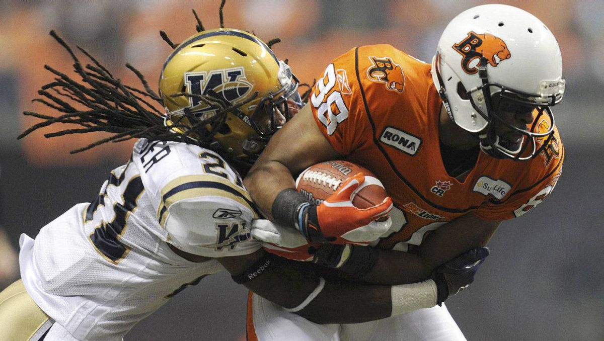 B.C. Lions wide receiver Akeem Foster is tackled by Winnipeg Blue Bombers defensive back Alex Suber.