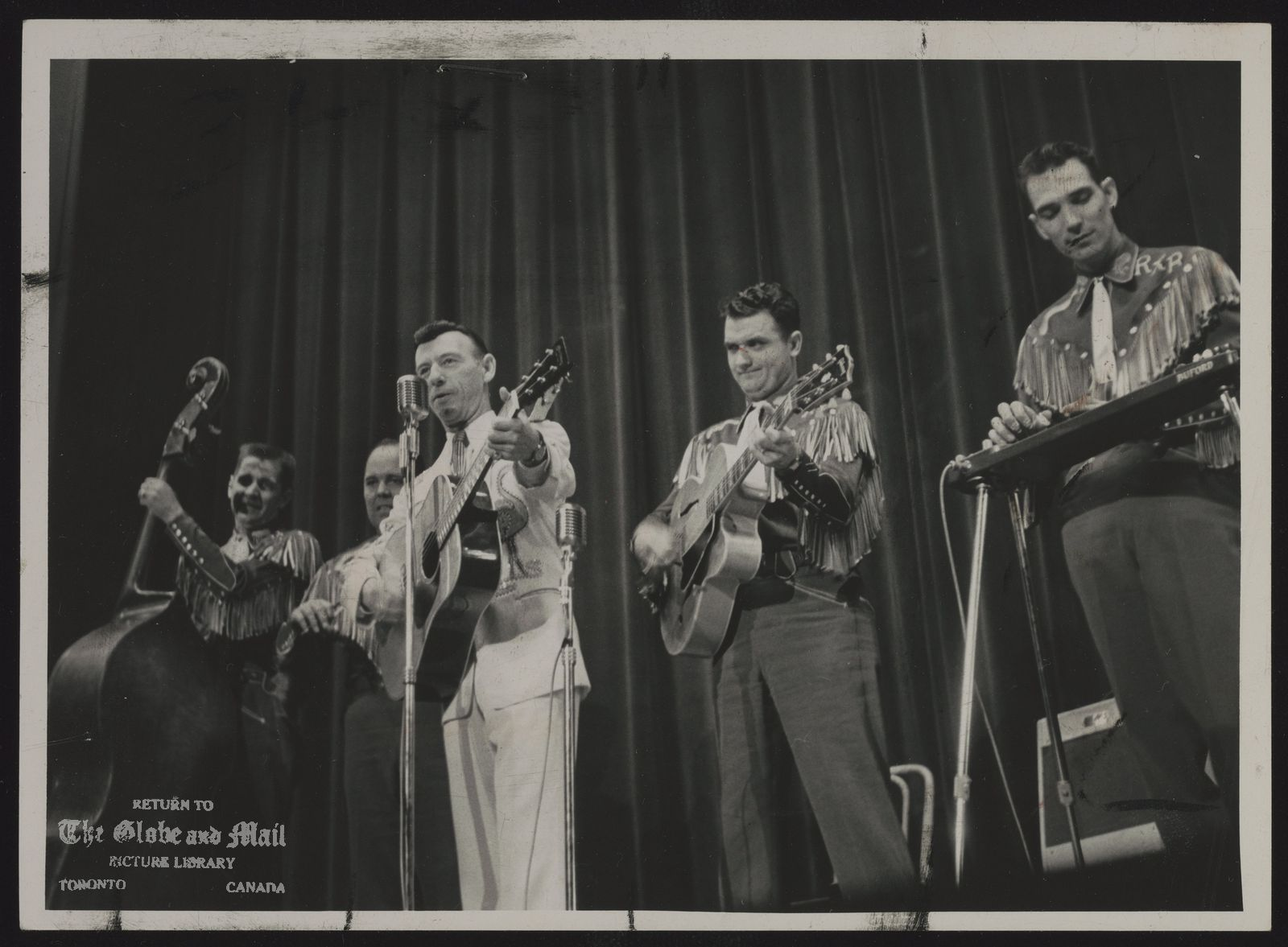 Hank SNOW [Personal appearances at vaudeville houses like Toronto's Casino help Hank Snow earn $250,000 a year. The boys warm up the audience. c. May 1957.]