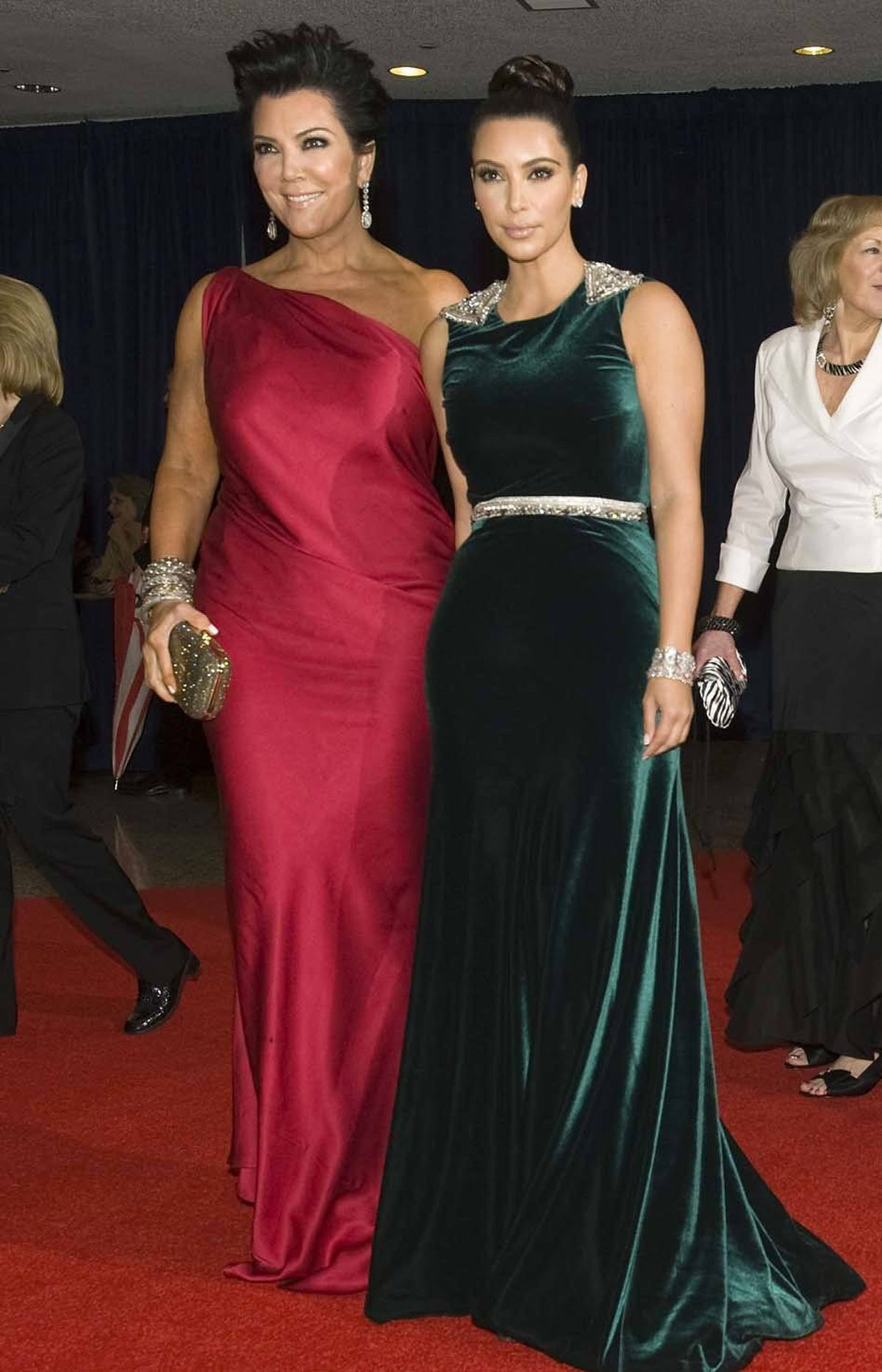 And what kind of serious journalistic gathering would it be without socialite Kris Jenner (left) and her maritally unencumbered daughter Kim Kardashian?
