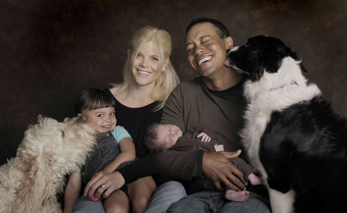 The Woods family -- Sam, Elin, Charlie and Tiger, along with dogs Yogi, left, and Taz -- poses for a portrait on Feb. 17, 2009. Charlie was born on Feb. 8.