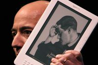 Amazon CEO Jeff Bezos holds the Kindle DX, which he unveiled at a press conference at the Michael Schimmel Center for the Arts at Pace University May 6, 2009 in New York City.