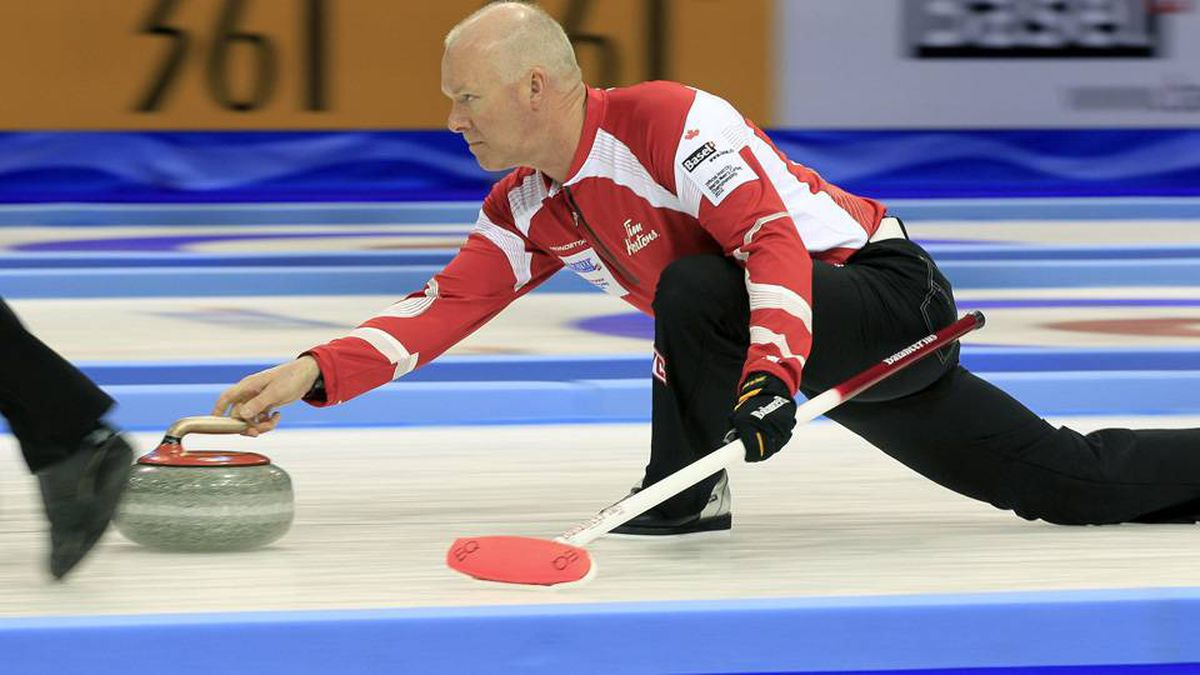 Canada skip Glenn Howard delivers his shot during play against Germany at the World Men's Curling Championship 2012 in Basel on Sunday.