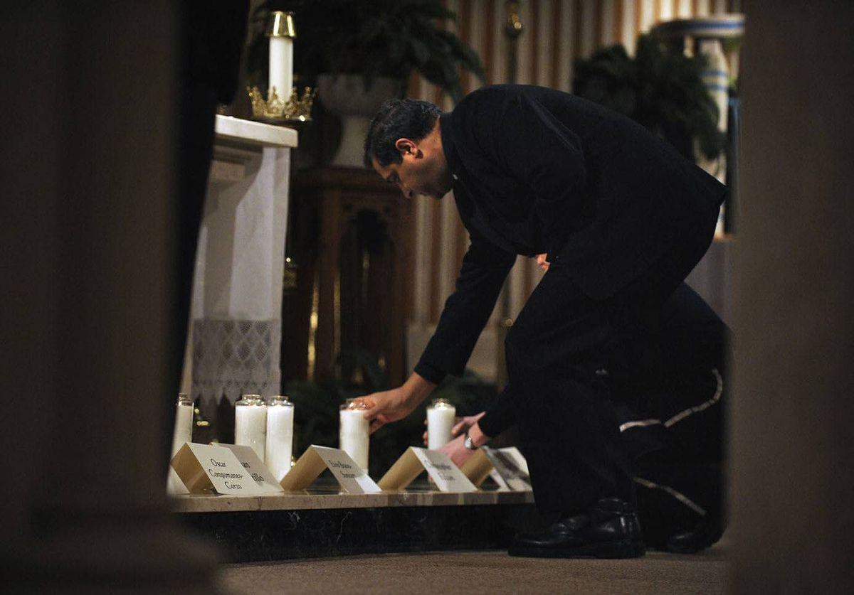 Candles are lit at a prayer service at St. Joseph Catholic Church in Stratford, Ont., for the 11 victims of a deadly traffic accident at nearby Hampstead, Ont..