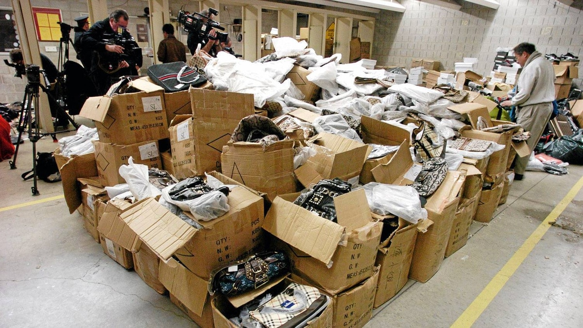 Counterfeit goods are displayed at a Toronto police press conference in 2007. Lawyers say brand owners, regulators and police have barely scratched the surface of a growing, multibillion-dollar illegal industry.
