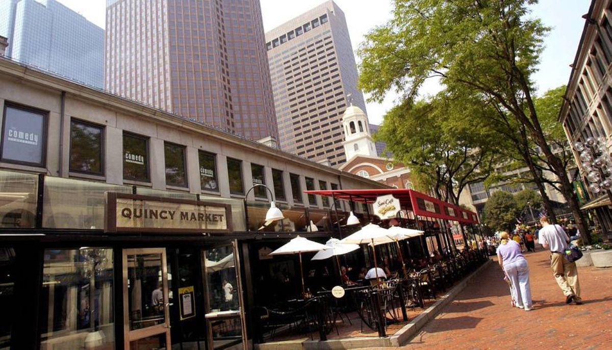 Shoppers stroll through Faneuil Hall Marketplace in Boston, a property owned by General Growth Properties.