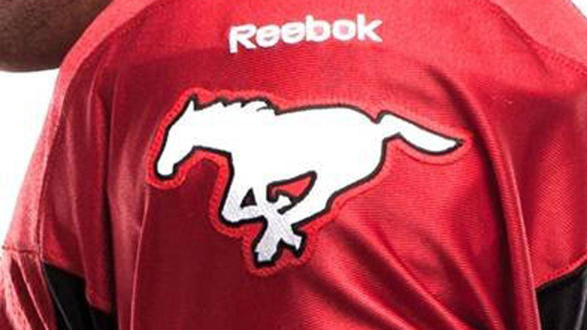 RB Jon Cornish shows off the Stampeders' new uniform.