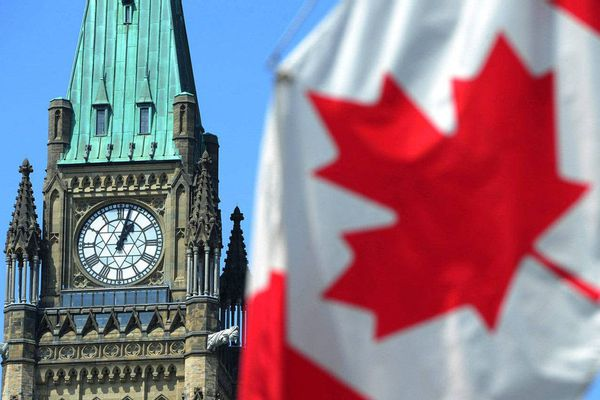 The Peace Tower and a Canadian flag are seen on Parliament Hill in Ottawa.