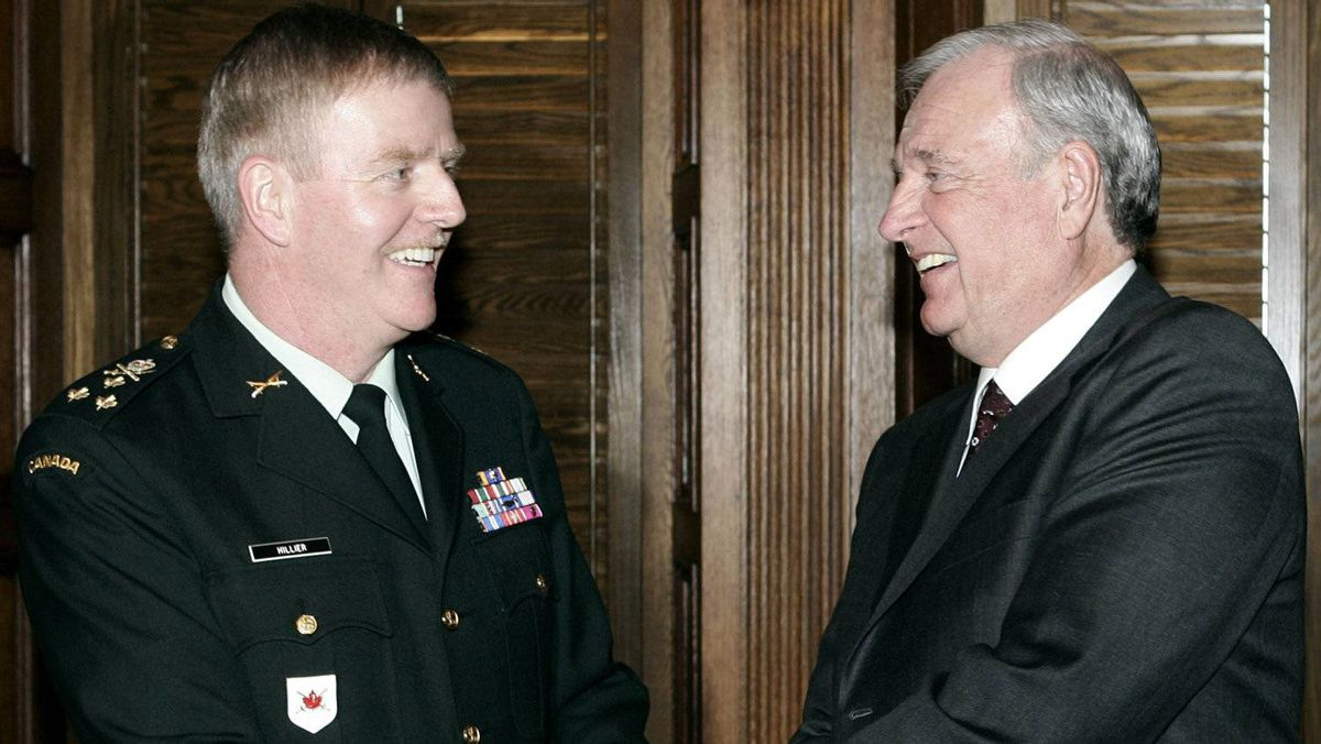 Former Canadian Prime Minister Paul Martin, right, meets with Gen. Rick Hillier in Ottawa, Jan. 14, 2005.