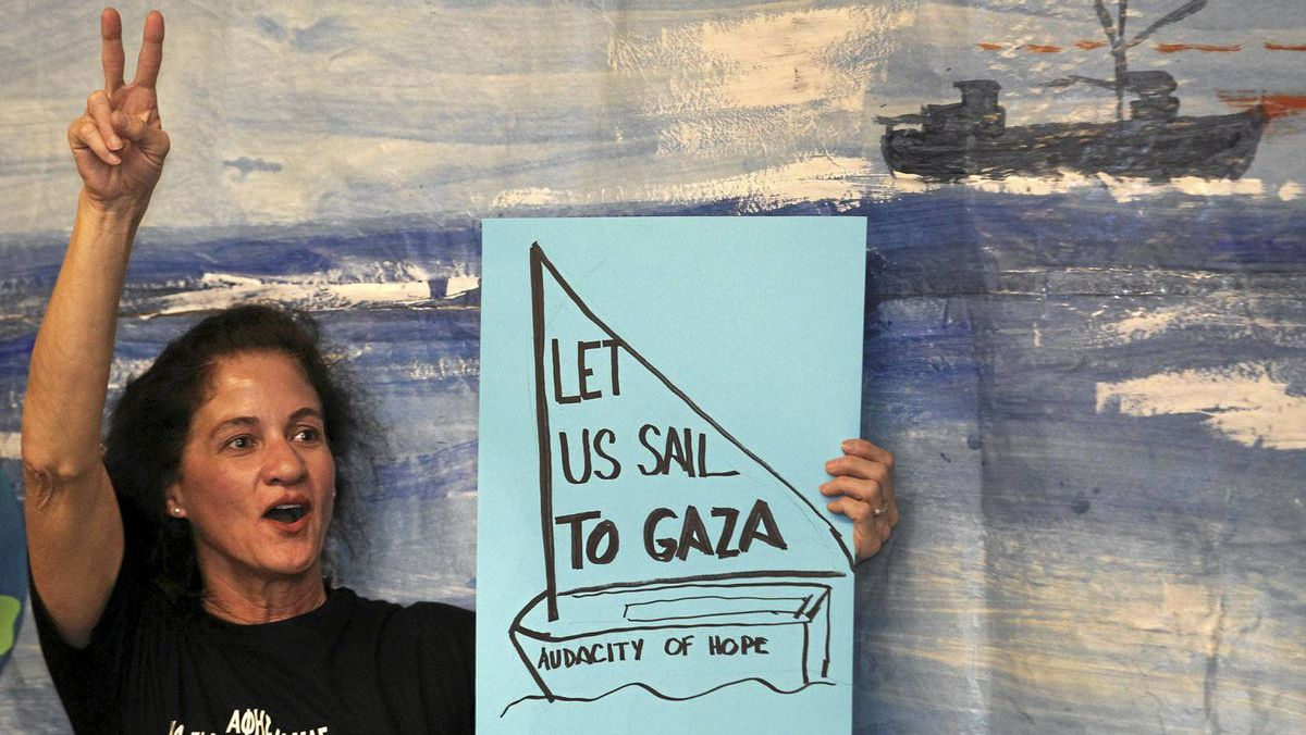 An activist takes part in a news conference in Athens announcing plans for a flotilla of ships to break the Israeli blockade of Gaza.