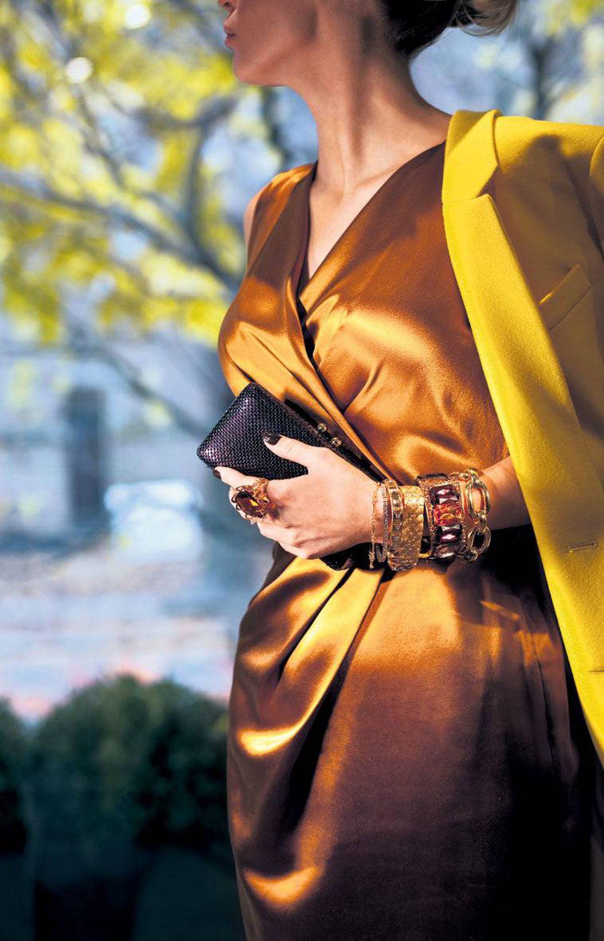 Ports 1961 sheath dress, $595 through www.ports1961.com. Balenciaga coat, $2,595 at Holt Renfrew (www.holtrenfrew.com). From left to right, Halston Heritage clutch, $195 at the Bay. Myles Mindham citrine ring, $6,000, gold bracelet, $500, diamond tennis bracelet, $14,750, gold studded bracelet, $10,850, hammered-gold bracelet, $6,900 through www.mindham.com. Rita Tesolin gold and purple cuff, $150. Myles Mindham 18-karat-gold bracelet, $13,400.