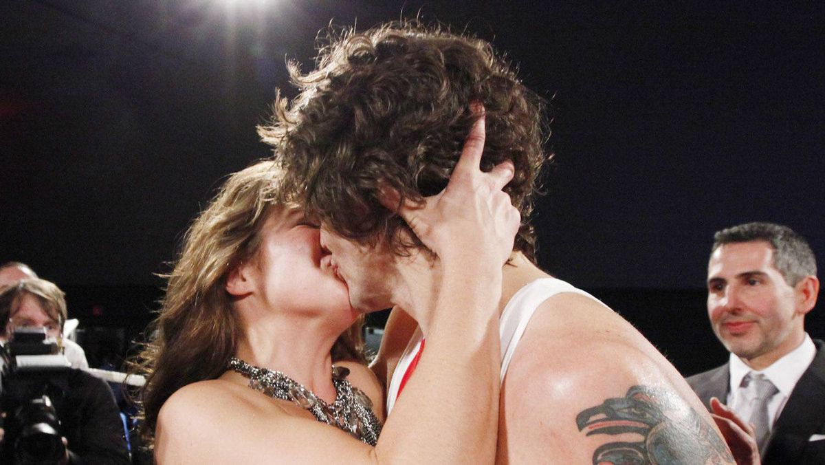 Liberal MP Justin Trudeau kisses his wife Sophie Grégoire after he won a boxing match against Conservative Senator Patrick Brazeau during charity boxing match for cancer research Saturday, March 31, 2012 in Ottawa.