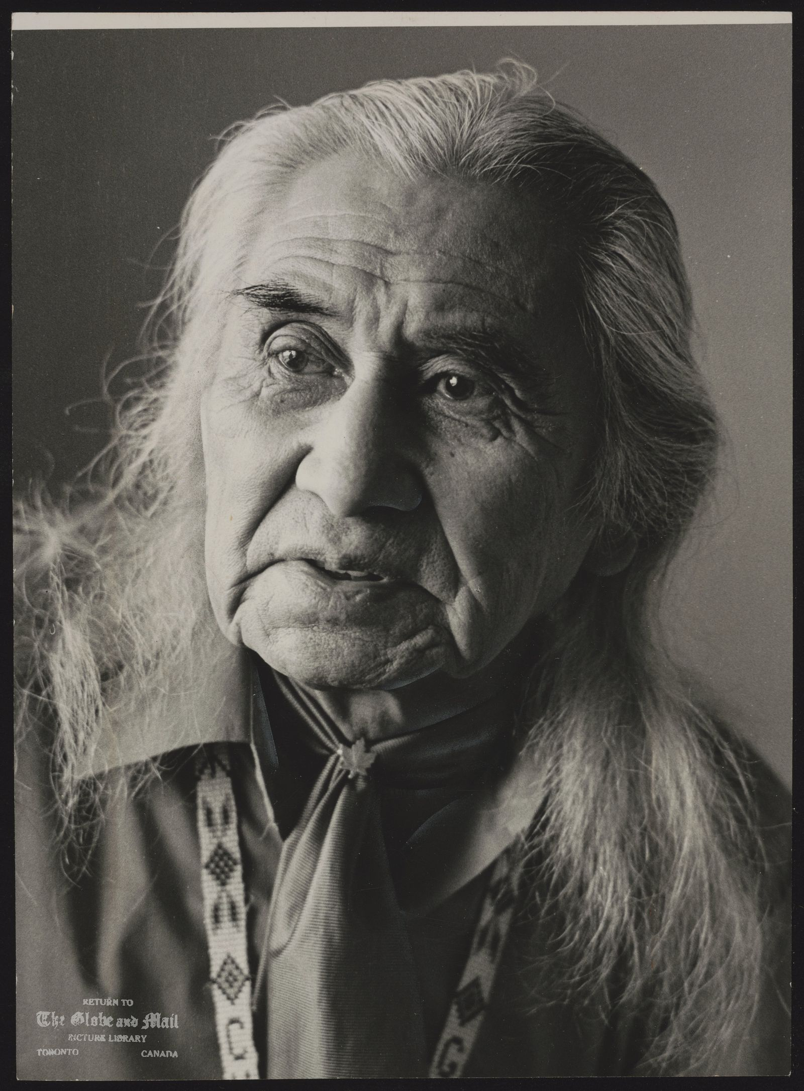 The notes transcribed from the back of this photograph are as follows: Dan GEORGE Vancover. Indian Chief, actor Chief George: truth in unreal world. Chief Dan George is 72 magnificent years old and possessed of grace and great grandfatherly style.
