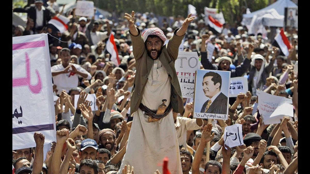 An anti-government protestor reacts as he and other demonstrators shout slogans during a demonstration demanding the resignation of Yemeni President Ali Abdullah Saleh, in Sanaa, Yemen March 1, 2011.