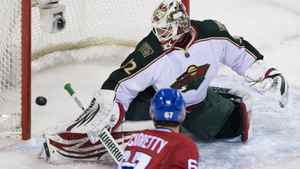 Minnesota Wild's goaltender Niklas Backstrom is scored on by Montreal Canadiens' P.K. Subban (not shown) as Canadiens' Max Pacioretty (67) looks for a rebound during first period NHL hockey action in Montreal, Thursday, March 1, 2012.