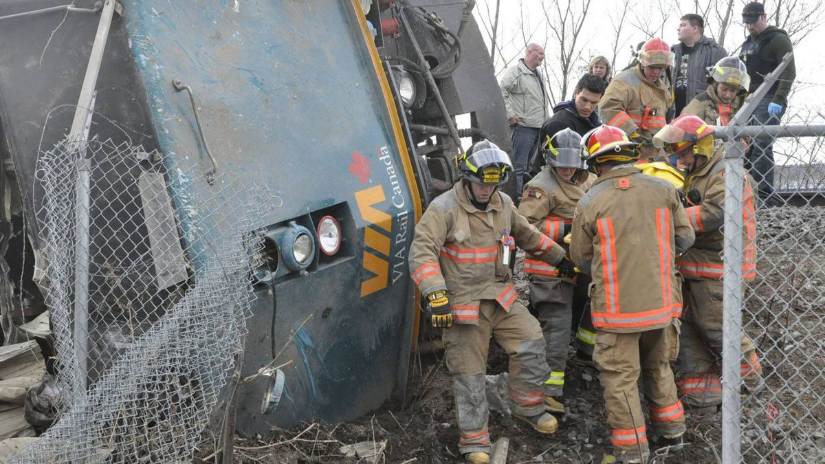Emergency crews help extract VIA passengers from a derailed train in Burlington, Ont.