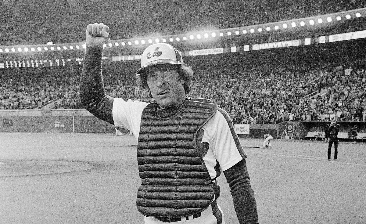 In this Oct. 9, 1981, file photo, Montreal Expos catcher Gary Carter winks at the cheering crowd and gives them the clenched fist salute as he leaves the field after the Expos defeated the Philadelphia Phillies 3-1 to take a 2-0 lead in the National League East Division playoffs Montreal. Carter, the first player enshrined in Cooperstown wearing a Montreal Expos cap, died Thursday. He was 57.