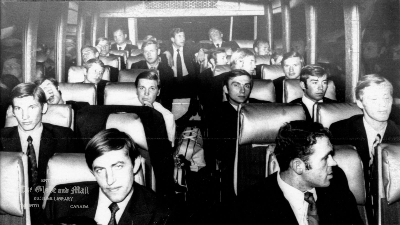 AUGUST 30, 1972 -- MONTREAL -- RUSSIAN HOCKEY PLAYERS ARRIVE -- Members of the Russian National Hockey Team ride a bus from Montreal International Airport Wednesday night, August 30, 1972, after arriving on a regular Aeroflot flight from Moscow. The Russians meet Team Canada for the first time Saturday night, Sept. 2, 1972. CP PHOTO