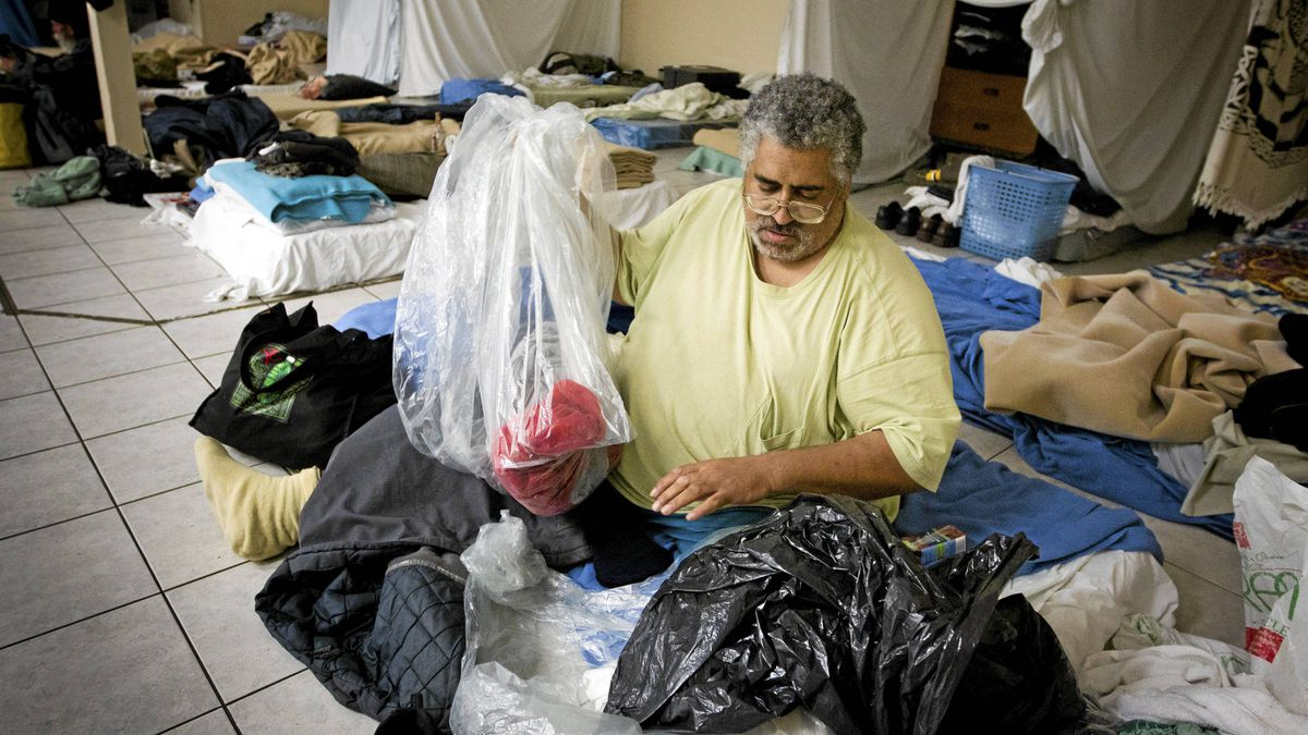 Jim Crawford unpacks his bags at homeless shelter in Vancouver December 16, 2010. The shelter provides space each night for up to 40 people and will operate until the end of April 2011.