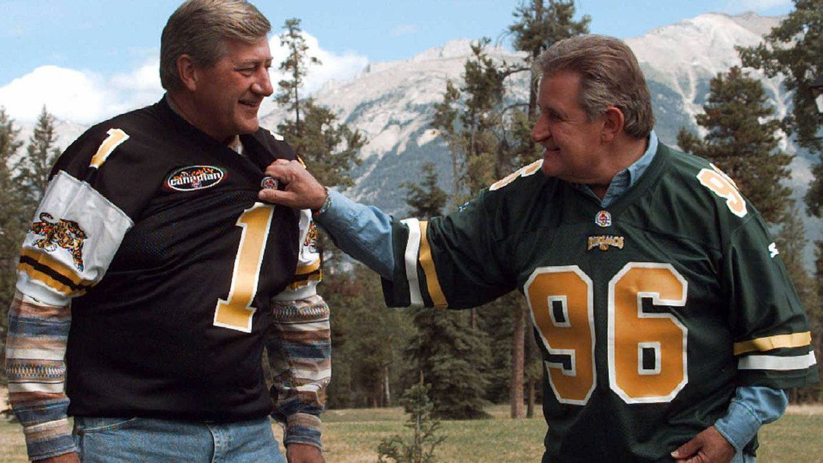 In a moment of competition, Ontario Premier Mike Harris and Mr. Klein donned CFL football jerseys during a break in the 37th Annual Premiers Conference in Aug. 22, 1996.
