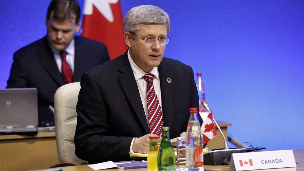 Prime Minister Stephen Harper and Foreign Affairs Minister John Baird take part in the first working session of the G8 Summit in Deauville, France, on May 26, 2011.