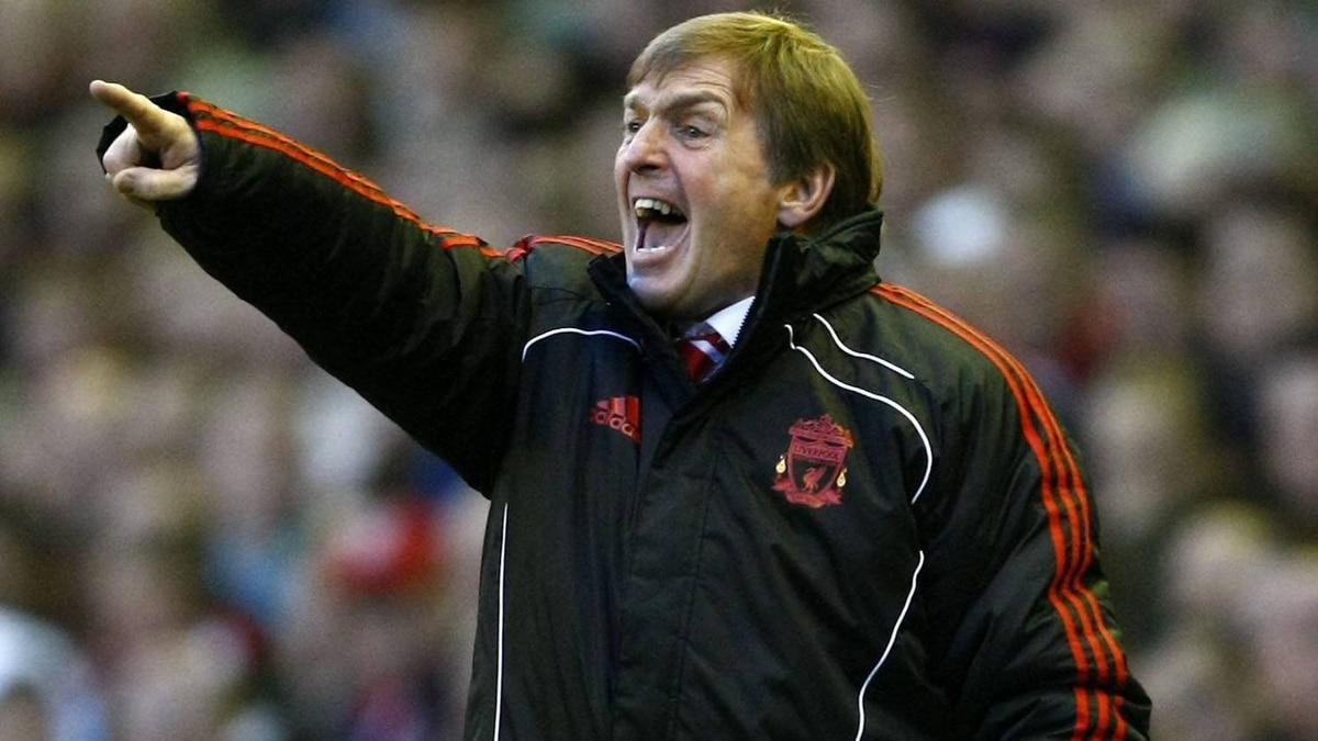 Liverpool manager Kenny Dalglish, left, reacts during their English Premier League soccer match against Wigan Athletic at Anfield, Liverpool, England, Saturday Feb. 12, 2011. The two teams tied 1-1. (AP Photo/Tim Hales)