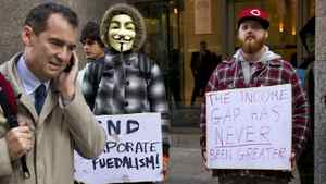 Occupy Toronto supporters demonstrate on King Street in Toronto on Oct. 17, 2011.