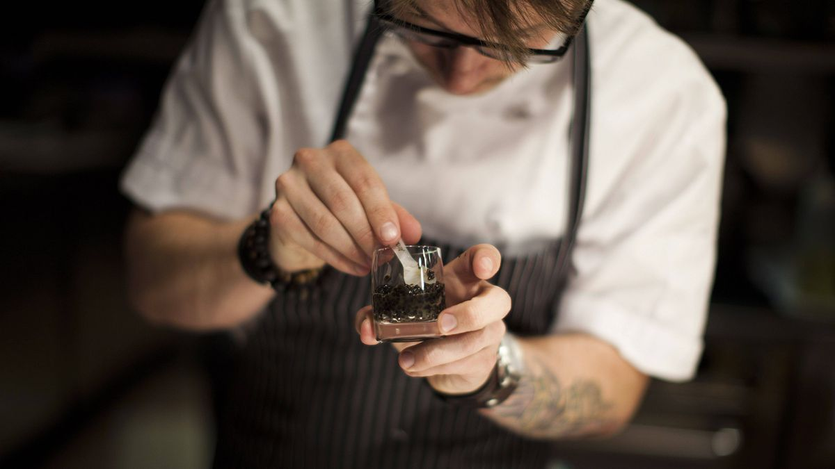 Sous chef Jimmy Stewart prepares caviar for a taste test at the Bearfoot Bistro in Whistler, B.C.
