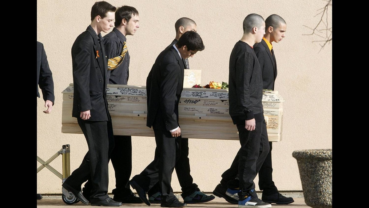 Pall-bearers carry the casket of Walter Borden-Wilkins during his funeral in Grand Prairie, Alberta on Thursday Oct. 27, 2011. Borden-Wilkins, 15, was killed in a car accident along with Matt Deller, 16, Tanner Hildebrand, 15 and Vincent Stover, 16, in Grande Prairie on Saturday.