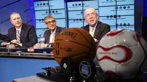 BCE CEO George Cope, left, Rogers CEO Nadir Mohamed and Larry Tanenbaum, chairman of MLSE, announce the sale of the sports company in Toronto Dec. 9, 2011.