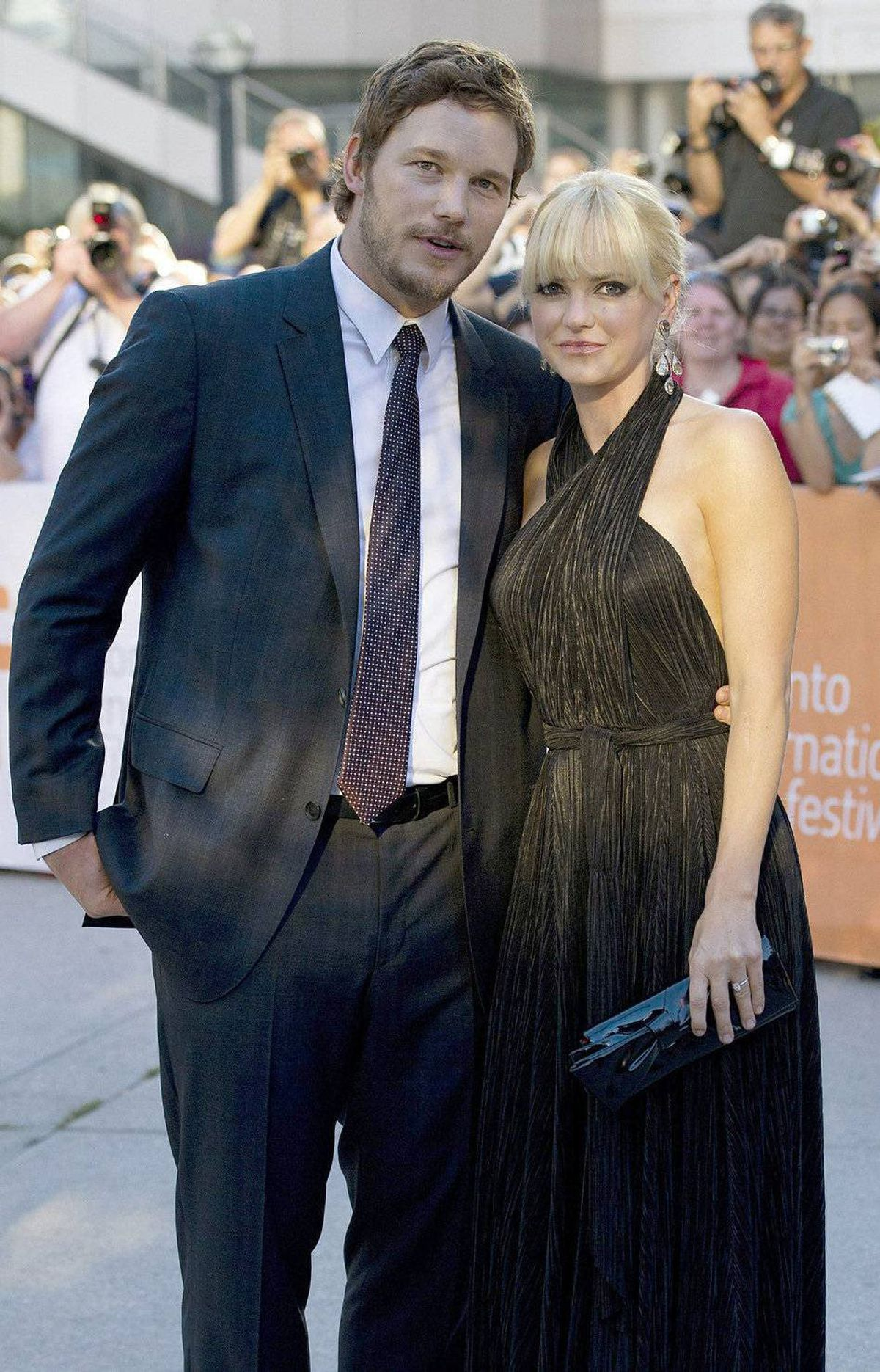 "Actors Chris Pratt, left, and Anna Faris, right, pose for a photograph while on the red carpet before the screening of the new movie ""Moneyball"" at the Toronto International Film Festival in Toronto on Friday, Sept., 9, 2011."