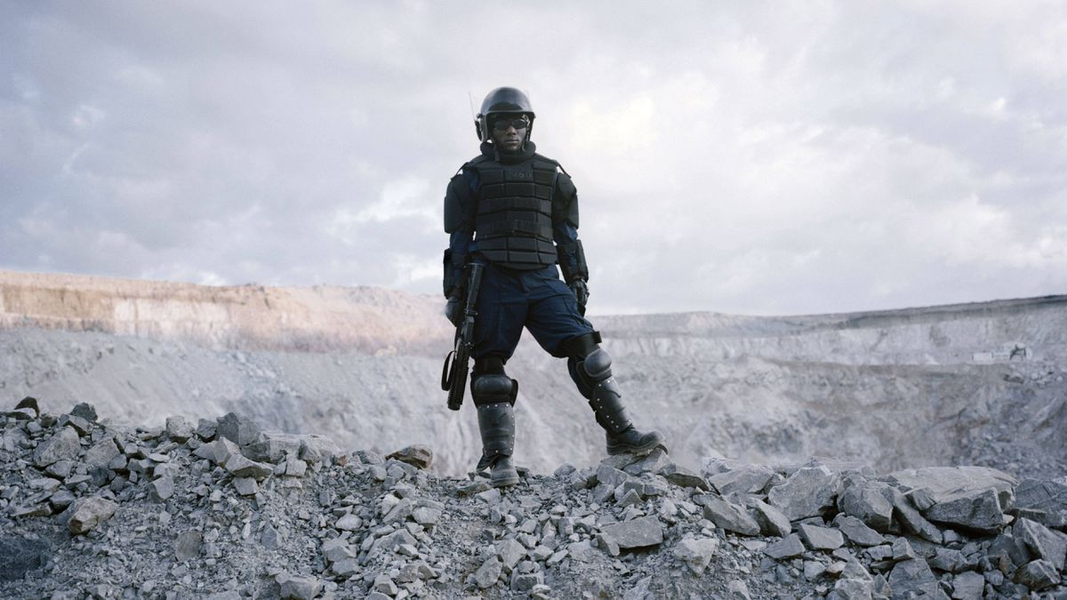 A Barrick private security officer stands guard at the North Mara mine. While disturbed by what's happened in Tanzania, Barrick's CEO says shutting down a mine that provides employment and benefits to thousands is not the solution.