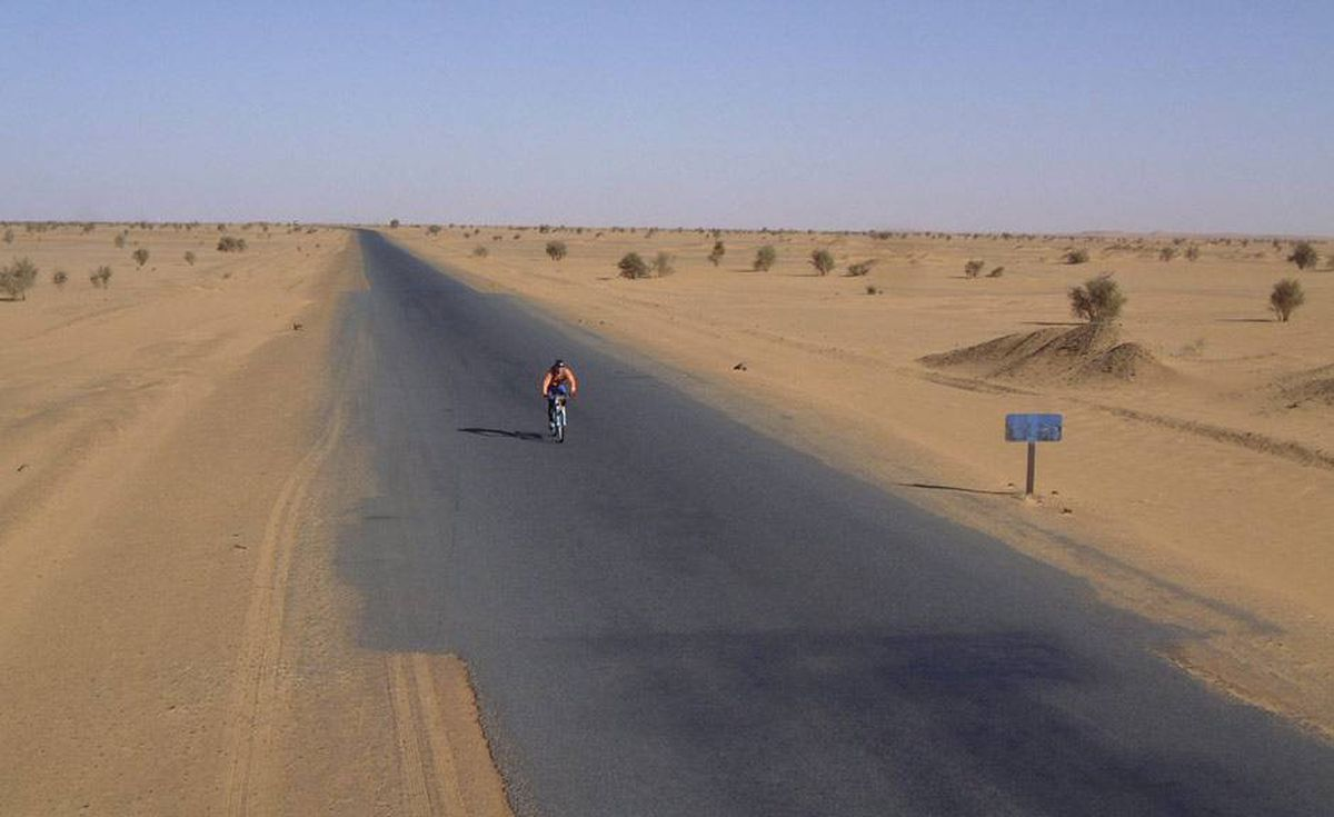 Riding along a desert road in the Sudan.