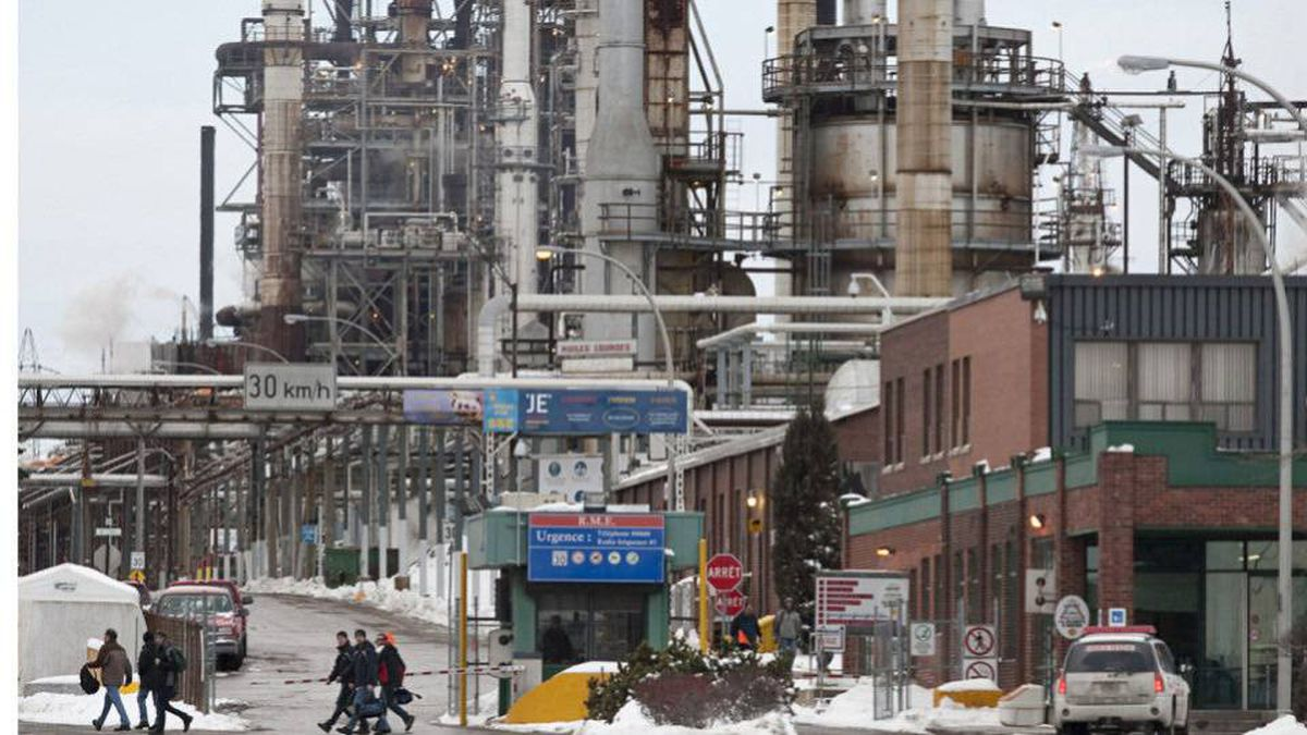 Employees leave the Shell Canada refinery in Montreal last January. The company announced Friday it will close the east-end facility and convert it to a distribution centre.